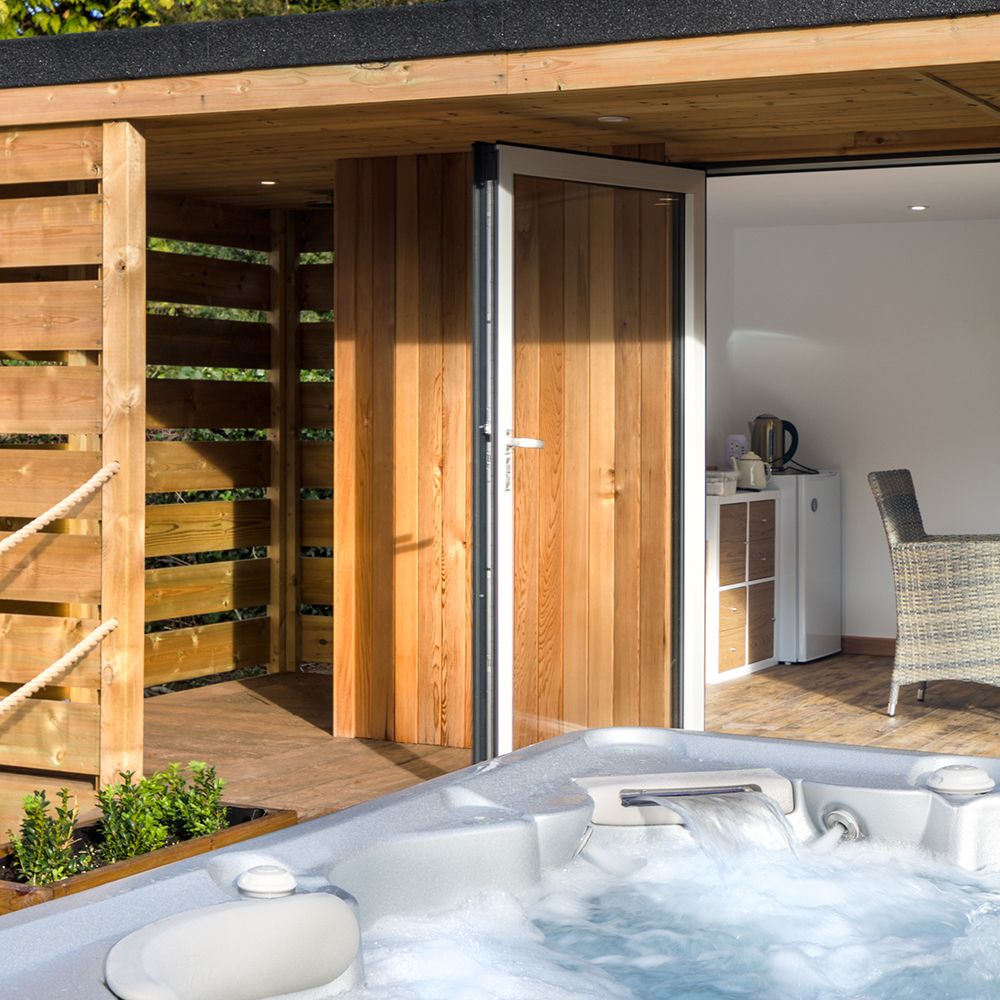 Hydropool Bristol offer self-cleaning hot tubs and swimspas, which offer the perfect addition to one of our garden rooms.