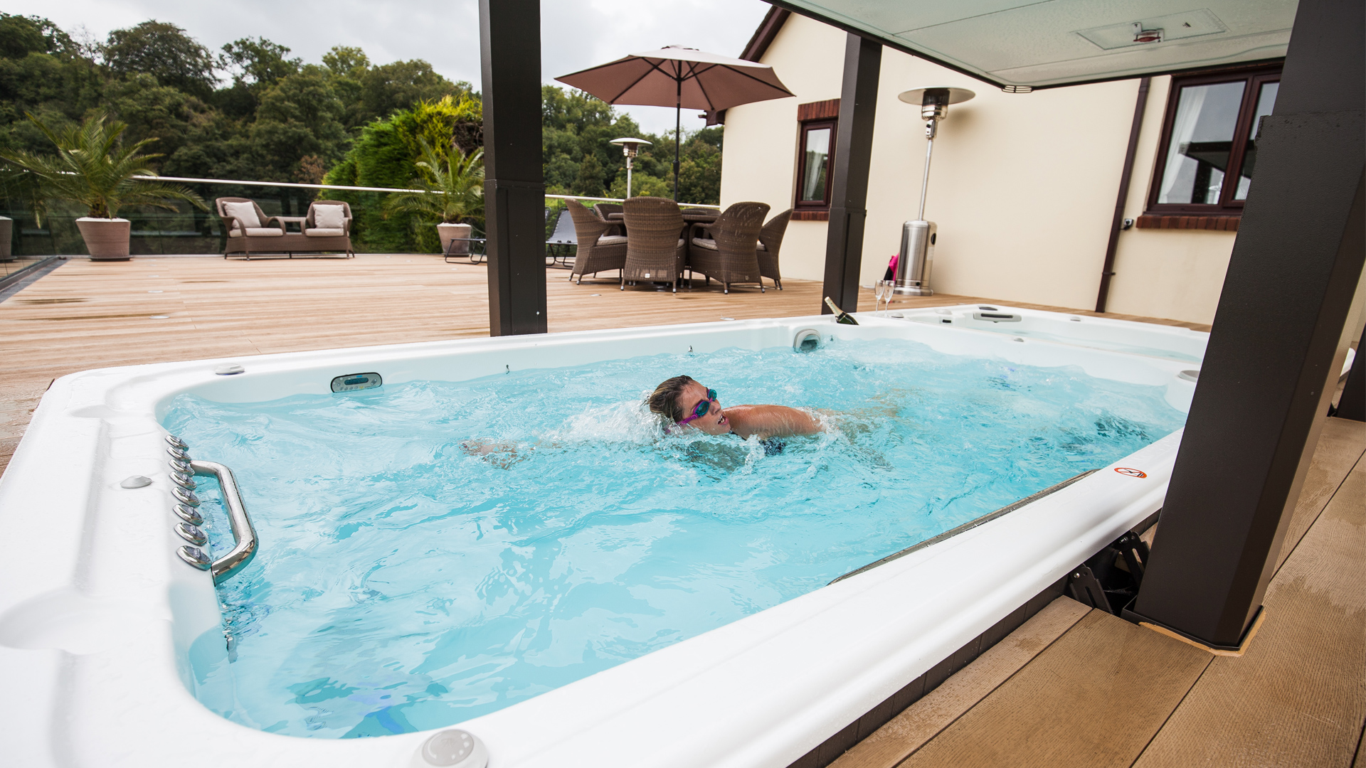 Swimmer in a Hydropool Swimspa from our Bristol hot tub & swimspa showroom. Our self-cleaning swimspas also double us a large hot tub.
