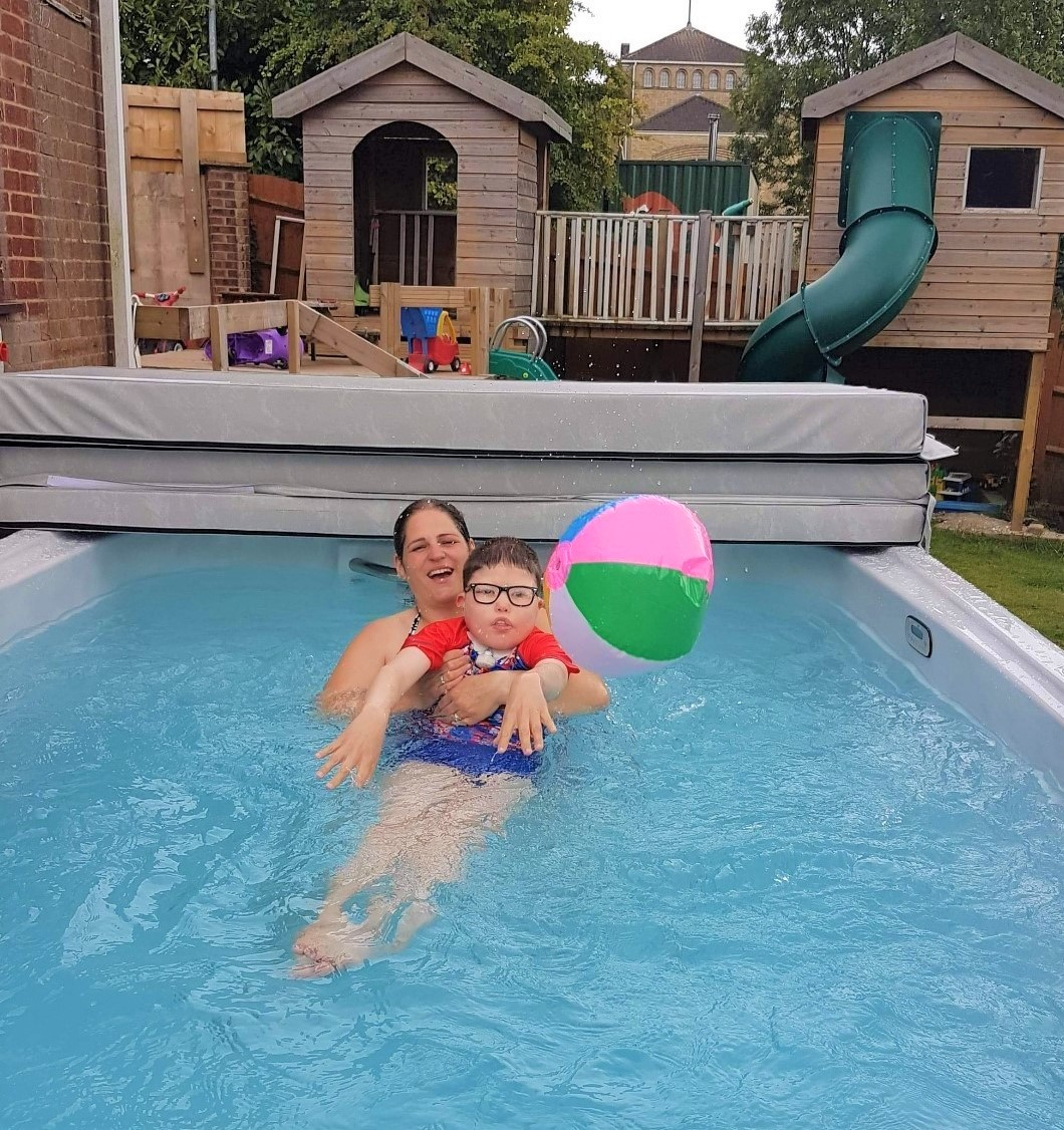 Jonathan in his HydroPool swim spa with mum Leanne
