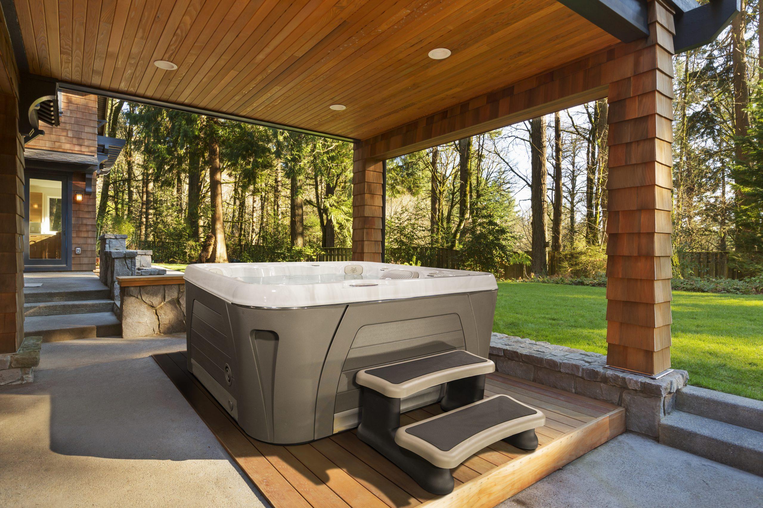 Hydropool Serenity installed on decking under pergoda in amazing garden